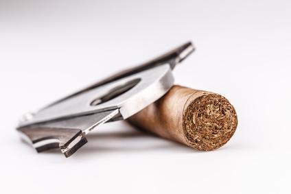 Zigarre und Cutter